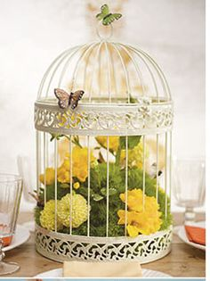 Birdcage Idea using Flowers  Butterflies Lovely...use this idea with one of our birdcages, part of the package at Stewart Family Farm Outdoor Weddings! http://www.stewartfamilyfarm.com