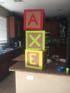 Letter blocks for step and repeat! Use 12x12 cardboard boxes, use painters take to get a crisp line and paint edges with acrylic paint!