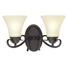 sophisticated swirls   Dunmore Two-Light Wall Fixture   Oil Rubbed Bronze Finish with Frosted Glass