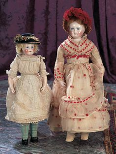 "Theriault's Antique Doll Auctions -  Gorgeous Classic French Bisque Poupee by Rohmer - 16"" and a 13"" French Porcelain Doll with Painted Eyes - also by Leontine Rohmer - both circa 1858"