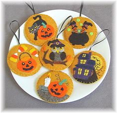 """These Halloween ornaments will look cute hanging on your favorite spooky indoor tree! Use individual designs for mug rugs or enlarge for punch needle/rug hooking projects. Finished Size: Ornaments/Mug Rug 3"""" Skill Level: Just Learning Technique: Wool Applique Easy Felt Crafts, Felt Diy, Crafts To Make, Halloween Rustique, Rustic Halloween, Fall Halloween, Halloween Applique, Halloween Patterns, Penny Rug Patterns"""