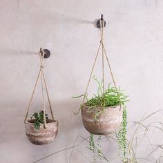 Buy the Affiti Hanging Clay Planter - Antique Grey - Large from Nkuku at AMARA. Free UK delivery on all orders over