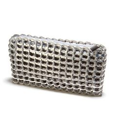 Chica Rosa in Silver. Made of crochet and recycled aluminum pop tops. #recycled #sustainable @Chic Luxuries #giveaway ow.ly/v9dim