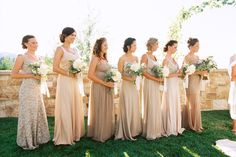 Taupe-toned bridesmaids all lined in a row Photography by Leo Patrone Photography / leopatronephotography.com, Floral Design by Honey of a Thousand Flowers / sarahwinward.com