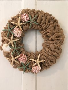 Burlap and starfish- a perfect combo for a pretty front door wreath!