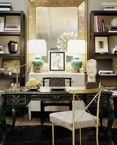 Glam home office.  The legs on that green desk are so gorgeous, and the gold accents (gilded mirror, sleek-legged guest chair, vintage lamp) bump the space from pretty to super chic.