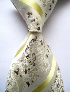 This is a lovely Ivory Yellow Brown Paisley Silk tie you can this rock with a cream colored suit, tan sport jacket, beige dress pants off-white shirt...so many endless possibilities.