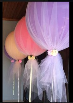 Festive and classy way to decorate with helium balloons.  Fresh flowers on the ties.