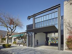 Completed in 2014 in Los Altos, United States. Images by Bruce Damonte, Andria Lo, Olson Kundig. Located in downtown Los Altos, the highlight of this square foot adaptive re-use project is the introduction of a new façade that enables the. Kinetic Architecture, Interior Architecture, Movable Walls, Pivot Doors, Street Gallery, State Street, Real Estate Development, Urban, Commercial Real Estate