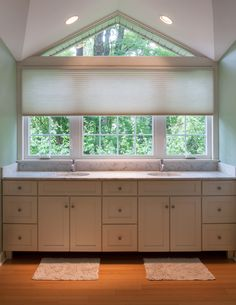 Triangle transom window in Master Bath Room gets a Motorized Honeycomb Shade in white to lighten things up and keep just the right amount of privacy.