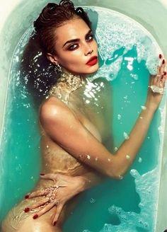 Cara Delevingne Love magazine smokey eye, defined dark eyebrow, red lip, dewy skin, contour, flawless skin