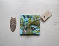 Raccoons And Flowers on a Turquoise by BluebellandtheFox on Etsy