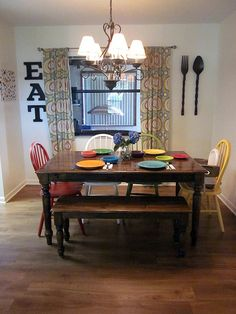This will be my kitchen one day. Different colored chairs are the way to go!