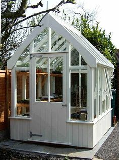 ♕ wood skirted greenhouse-darling and just the right size for me. Well, maybe not, maybe three times bigger.