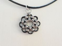 Black and Silver Chainmail Flower necklace and by DevTerDesigns, $18.00
