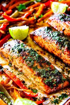 Sheet Pan Fajita Salmon with Cilantro Lime Butter - this salmon is the best I've ever tried! SO flavorful and juicy and the Cilantro Lime Butter is incredible! I serve this with rice and beans for a complete easy, delicious meal!