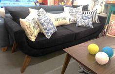 """Sofá """"U"""" 200x72 tapizado en simil pana, con asiento de placa soft y patas de madera."""