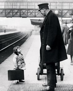 Which platform?  a very young passenger asks a station attendant for directions, on the railway platform at bristol, england, 1936. photo by george w. hales. so cute!