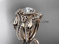 "14kt rose gold celtic trinity knot engagement ring, wedding ring with a ""Forever One"" Moissanite center stone and double matching band CT789S"
