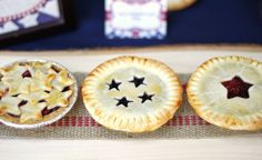 To give these little pies a festive touch use filled store-bought mini pie crusts {graham cracker crusts in the baking aisle of the grocer} with either blueberry pie filling or cherry pie filling. Then covered them with star cutouts made with refrigerator pie dough.