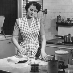 The 1950's housewife stereotype shows a woman who spent her time at home, catering to her husband and children.