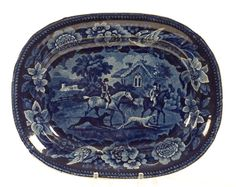 """ca 1821-1825, and attributed to James & Ralph Clews; dark blue underglaze-printed central design of two mounted huntsmen with running greyhounds beside and cottages in the background; floral and songbird border; unmarked; impressed below with number 10; 10.5"""" x 8.5""""."""