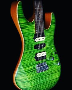 Aaaaah .... green is good. What a gorgeous Suhr!