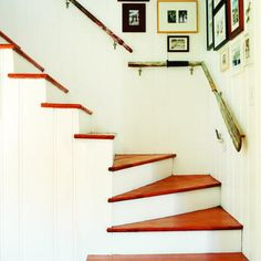 Clever oar handrails. More here: http://www.completely-coastal.com/2009/02/decorating-nautical-with-wooden-oars.html