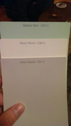 Nursery color pallete. Gray walls, white trim, and one mint/grey chevron accent wall
