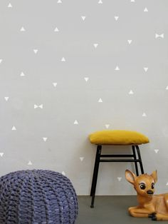 Mini White triangles wall decals.  These geometric triangle wall stickers are a perfect option for your wall decorating. Gives you the freedom to make