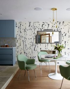 This kitchen and dining area could work in a house or an apartment. Love the statement wallpaper!