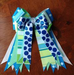 Equestrian bows that pop with energy. Happy bows, gorgeous with any jacket or pony.  $30 through Etsy.   Click on picture for more details.  www.etsy.com/shop/bowdanglesshowbows