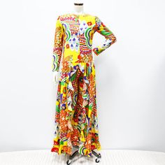 """1960-70s psychedelic print long sleeve dress with an open front and matching pants set. Fabric covered button down front. Fair condition, shows some wear, one of the buttons has been replaced. Bust: 34"""" Length: 56"""" Shoulder: 4"""" Sleeve: 22"""" Waist: 32""""."""