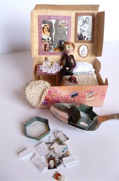 miniature doll in a box. hmmmm... portraits of friends for christmas? easy to ship...