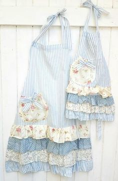 Very pretty Mommy and Me set of aprons in blue stripe with pretty floral ruffles. Mommy and me apron set. - Very pretty Mommy and Me set of aprons in blue stripe with pretty floral ruffles. Mommy and me apro - Ruffle Apron, Apron Dress, Cute Aprons, Sewing Aprons, Apron Designs, Creation Couture, Aprons Vintage, Linens And Lace, Mommy And Me