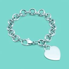 Heart tag charm bracelet. Sterling silver. Love this bracelet. However not for work, the charm is annoying when typing :-)