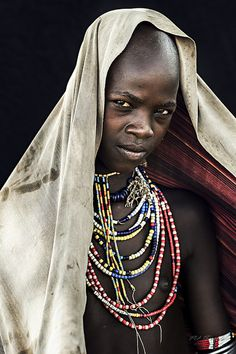 """Young Girl from the Arbore Tribe, South Omo Valley, Ethiopia.  The Series """"African Vogue"""" contains about 300 portraits of tribe members of the Omo Valley in Ethiopia. (Including members of the Arbore Tribe, Mursi Tribe, Nyangatom Tribe, Bodi Tribe, Hamer Tribe, Benna Tribe, Konso).  The pictures were taken in October 2013 - All pictures were taken in natural light situations with a Leica S digital middle format camera.  All pictures were taken in natural light situations with a Leica S…"""