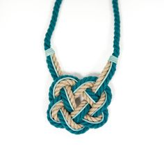 Teal blue natural statement rope necklace, Celtic heart knot, Trinity knot, decorative knot necklace, jute rope, folk inspired, ethnic, textile jewelry, Baltic, blue, teal by NativeSenseStore on Etsy. Materials: cotton rope, Amanawa linen hemp rope, leather strip, leather badge.