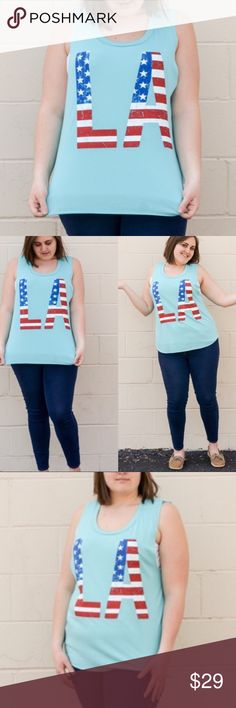 PLUS Patriotic LA tank Super cute and so soft! Patriotic LA tank is blue with American flag lettering. Incredibly soft rayon, poly & spandex blend. MADE IN USA NEW boutique item. ⭐️Shop with confidence, I'm a Poshmark suggested user⭐️ PLUS SIZE Kyoot Klothing Tops Tank Tops