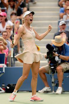 Caroline Wozniacki wears Adidas by Stella McCartney at 2014 US Open - yellow peplum lining and shorts