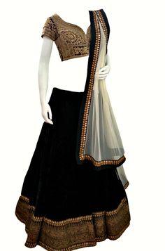 black, gold and white lehenga with blouse