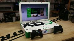 """Modder Ed Zarick's """"Xbook Duo"""" Console. Modified Laptop Combines Both the Xbox 360 and Xbox One Into a Single Unit."""