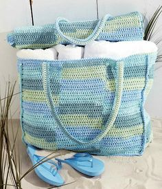 """How perfect is this - a roomy beach bag with a mat that you can roll up and tuck into the bag with your other things. Measures approx. 17"""" x 60"""" (43 x 152.5 cm) unfolded. Shown in Bernat Handicrafter Cotton Stripes, using 4 mm (US G or 6) crochet hook. (Yarnspirations)"""