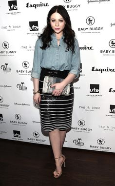 Michelle Trachtenberg combines a chambray top with a sequin striped skirt for a look that we don't quite get. To add to the chaos, she includes leopard print heels and a snake print clutch. It's getting a little cluttered in terms of prints!