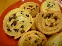 Peanut butter-Chocolate chip Cream cheese Pinwheels (could use cresent rolls instead of pie crust...great with coconut too!)