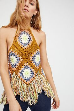 With a retro-inspired design, this crochet halter top features a statement fringe trim in an asymmetrical design. #slidesoutfit