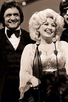 Johnny Cash & Ronny Milsap present Dolly with the highest honor of the night...