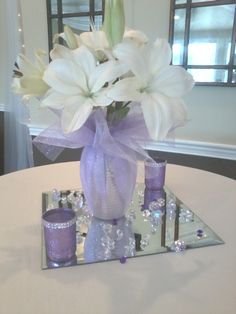 Purple Wedding Flowers Large flowers in vase wrapped with pink or purple colored tulle/organza and ribbon, two or three votive candles or floating candles around [option Wedding Table Decorations, Party Centerpieces, Decoration Table, Tulle Centerpiece, Tulle Decorations, Purple Wedding Centerpieces, Wedding Colors, Wedding Flowers, Anniversary Parties