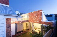 Mixing Modern: 8 Architectural Extensions Enhancing Traditional Red Brick Homes