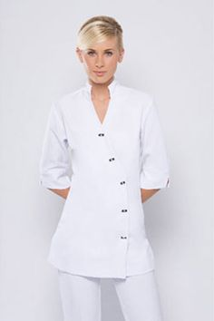 SPA15 TUNIC This is a 3/4 sleeve tunic, buttons to side on front of tunic. Mandarin collar. This is the same as the SPA05 tunic but with a 3/4 sleeve. This tunic does run a little bigger than our other tunics. Made from a corporate grade two way stretch fabric, easy wash and wear Available in sizes 6 - 24. Black and white only. ( white made to order- allow 2 weeks for the white ) ( white fabric is a heavier weight and not see through) Ready for immediate delivery